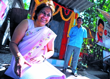 Parimala Bhat reads Sparshdnyan, one of the world's few newspapers to cater to the visually impaired.